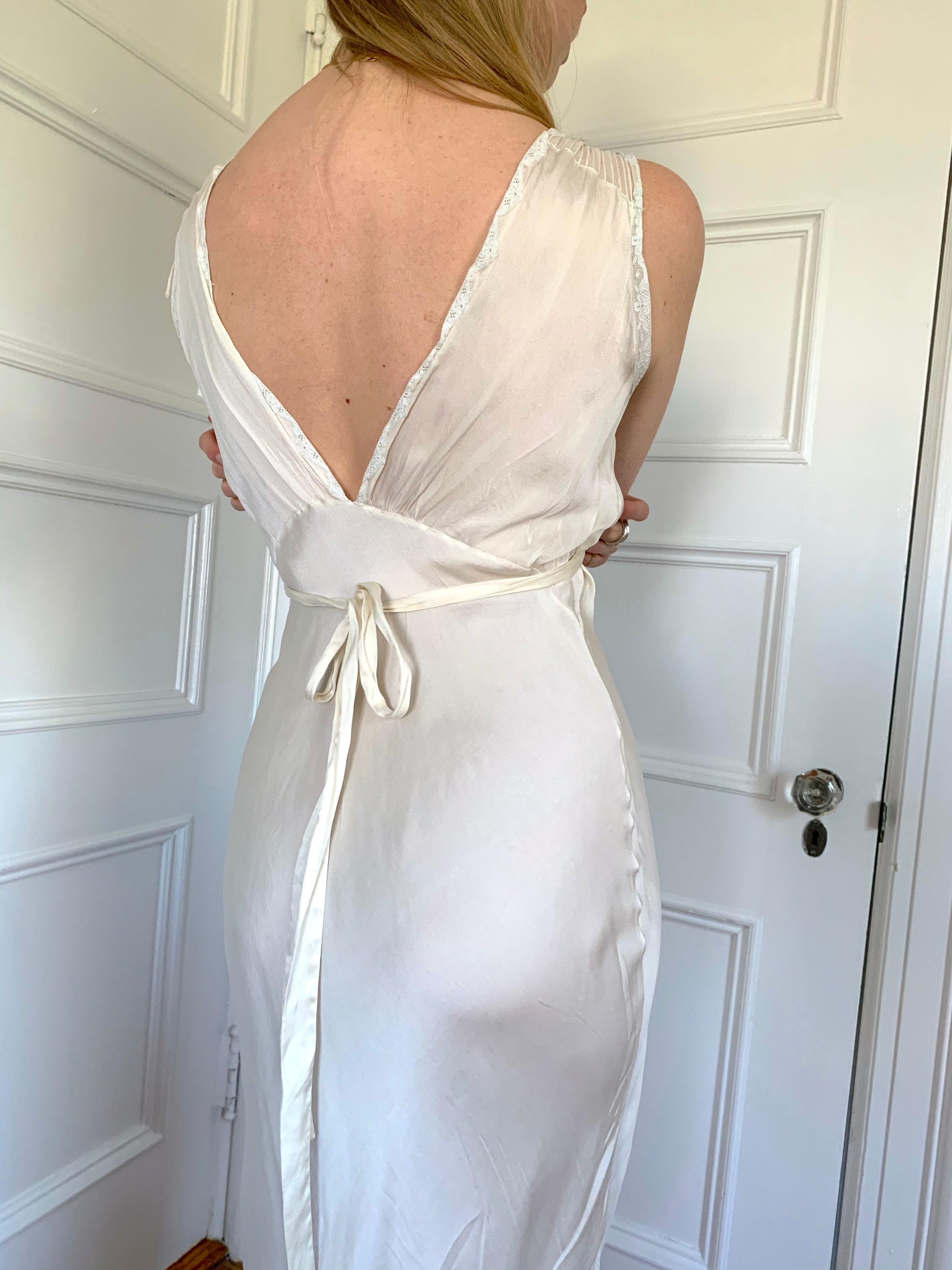 White silk slip with white lace detail