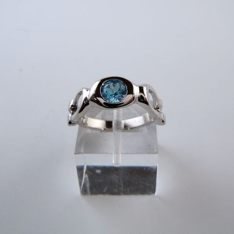 Blue Topaz Horseshoe Ring in Sterling Silver