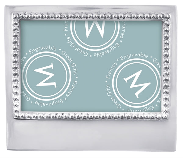 A silver frame with silver beading around photo opening and a wide bottom for engraving.