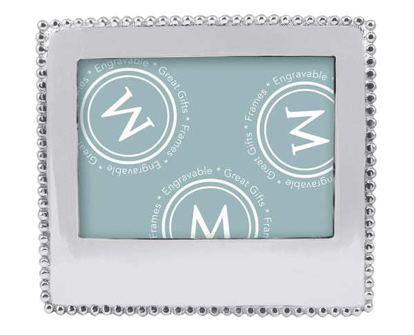 A horizontal positioned silver frame with silver beading around border. There is a larger space at bottom for engraving.