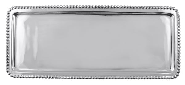 Silver elongated tray with silver beads around the edge.