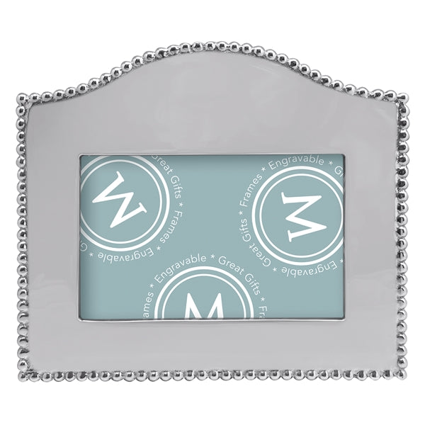 A silver frame with an arched top and silver beading around the outer edge.