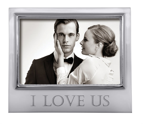 "A silver 4x6 horizontal frame with ""I LOVE US"" engraved in all caps at the bottom in a block font."