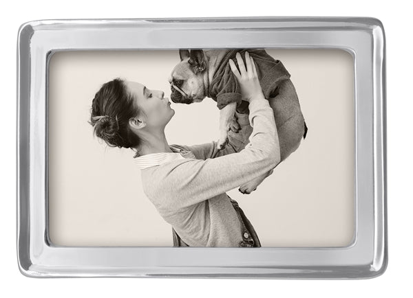"A silver edged 4"" by 6"" frame with a stock picture of woman kissing her dog."