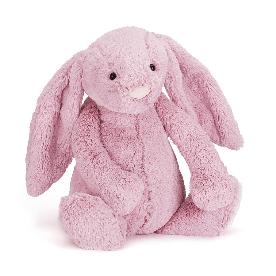 A tulip pink plush bunny sitting on a white background