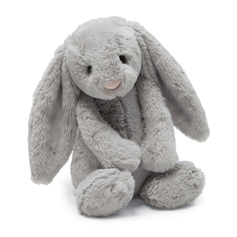 A plush grey bunny sitting on a white background