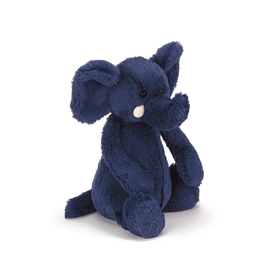A navy blue plush elephant with white tusks.