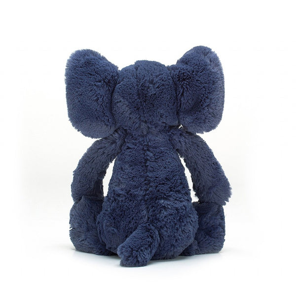 The back side of a navy blue plush elephant.
