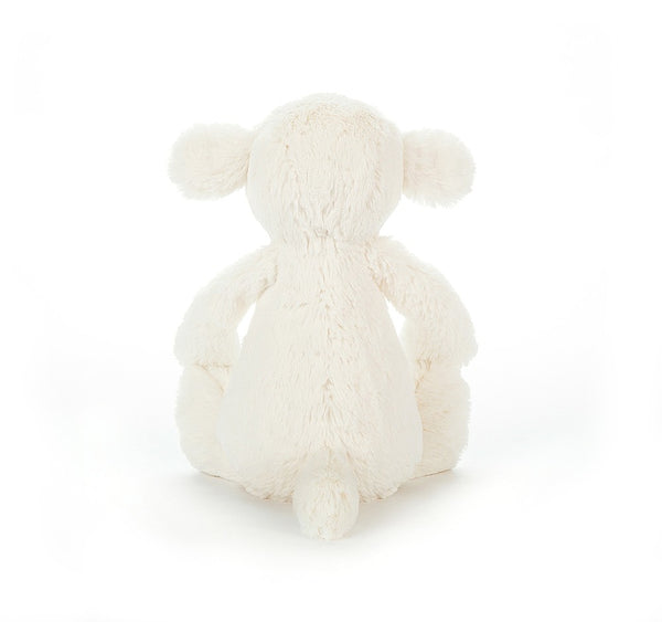 The back side of a plush white little lamb.