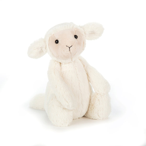 A small white fluffy plush lamb with a cream colored sweet face.