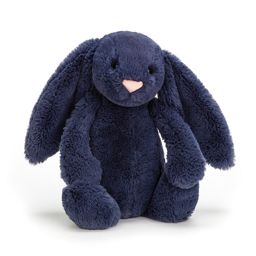 A navy plush bunny sitting on a white background.