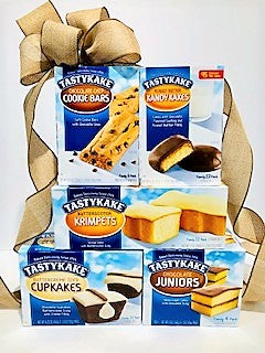 Tastykake baked goods stacked high with a big burlap bow.