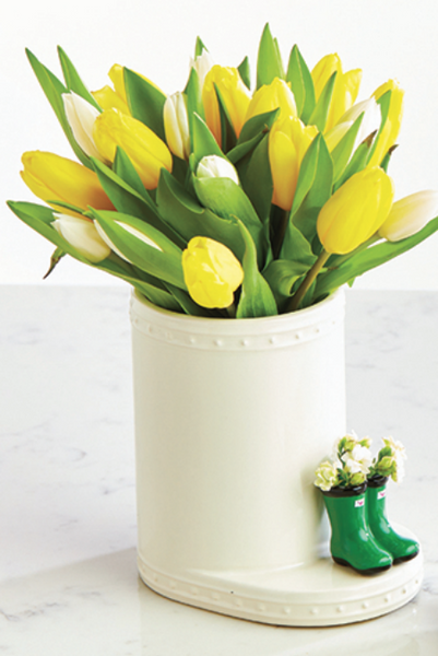 A beautiful arrangement of yellow tulips in a nora fleming porcelain vase.