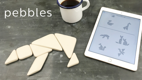 Pebbles sustainable tangrams are the first game designed by Bambino in biodegradeable bamboo