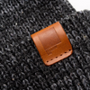 Mystery Beanie | Black | Leather label | closeup