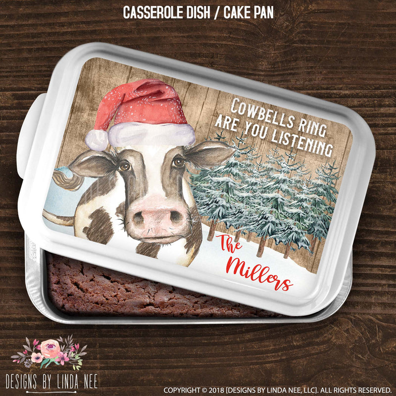 cake pan with christmas scene featuring santa hat cow alongside cowbells ring quote