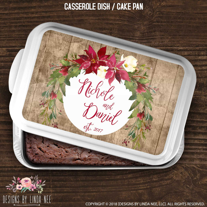 cake pan with poinsettia swag over family name and year