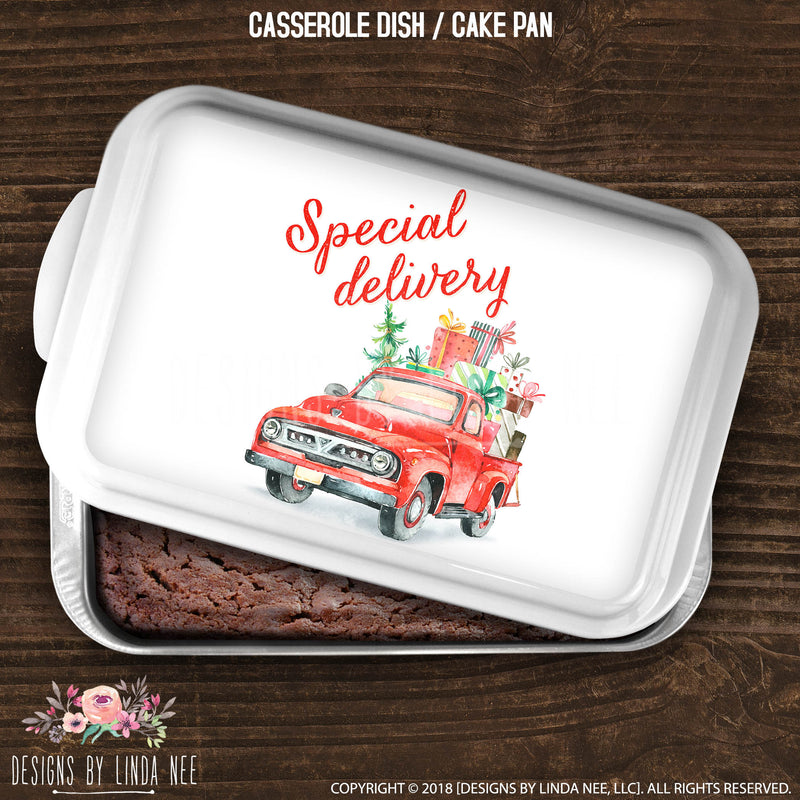 cake pan with holiday presents in back of red truck with Special Delivery written above