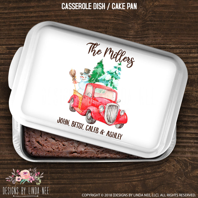 cake pan with family name over red vintage truck carrying trees and snowman with individual names underneath