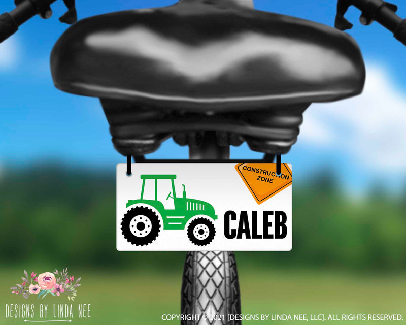 Kids style graphic bike plate with Green Tractor Under Construction Zone Sign