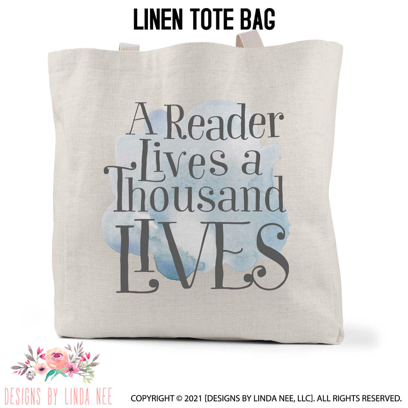 A Reader Lives A Thousand Lives text imprinted on a blue cloud linen book bag
