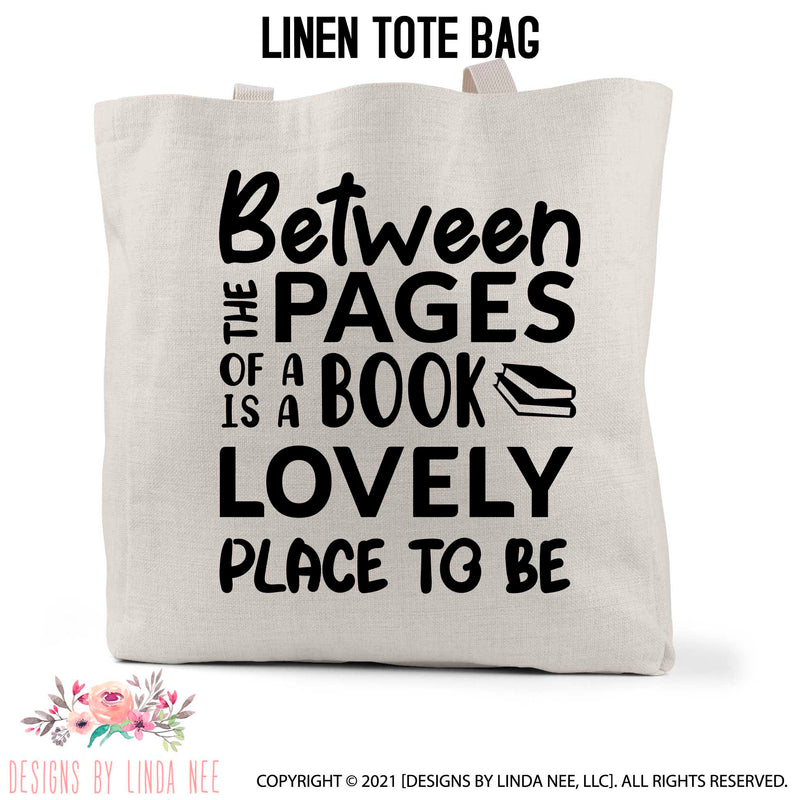 Between the pages of a Book is a Lovely Place to be text with books stack icon on a linen book bag