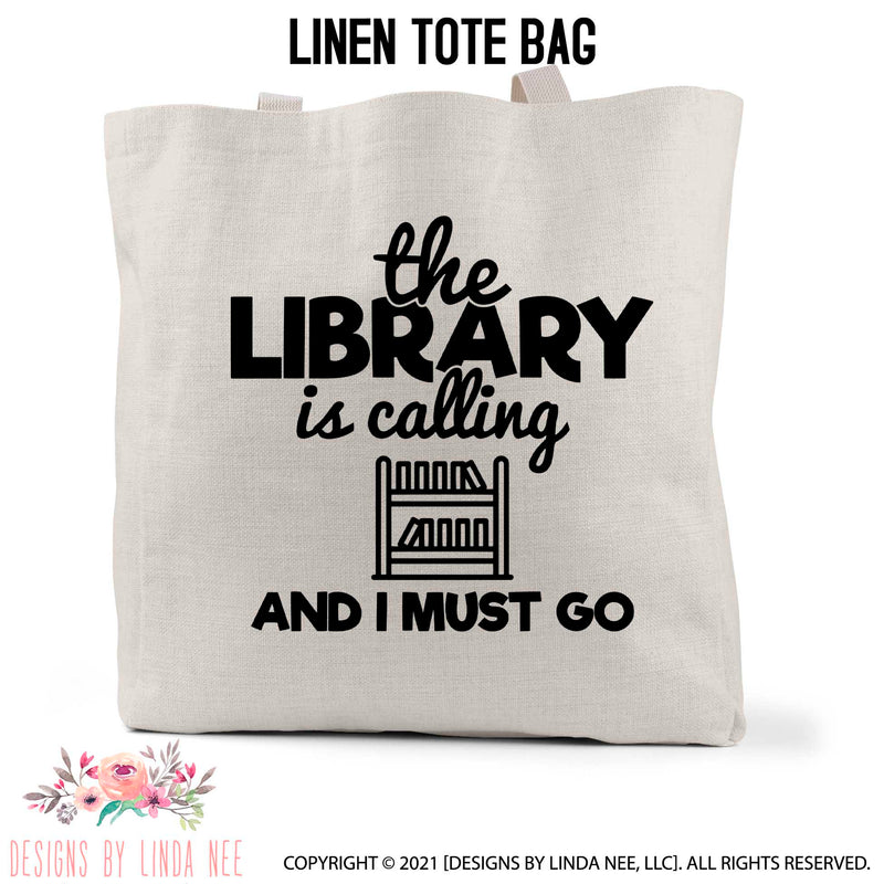 The Library is calling and I must go fun font on a linen book bag with a book shelf icon
