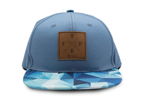 blue kids fashion snapback hat with leather brand label