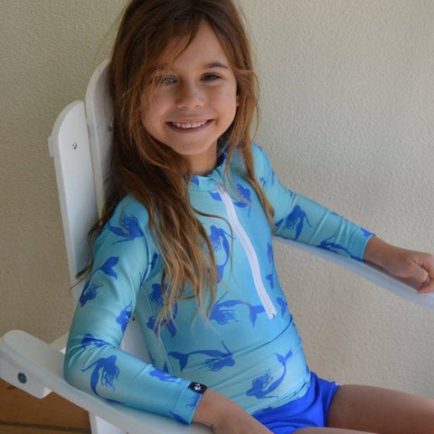cute child wearing blue mermaid print swimwear