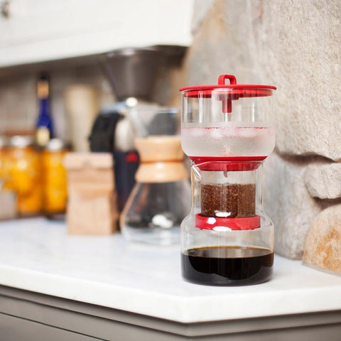 Cold brew system on a kitchen bench, coffee grounds dripping through