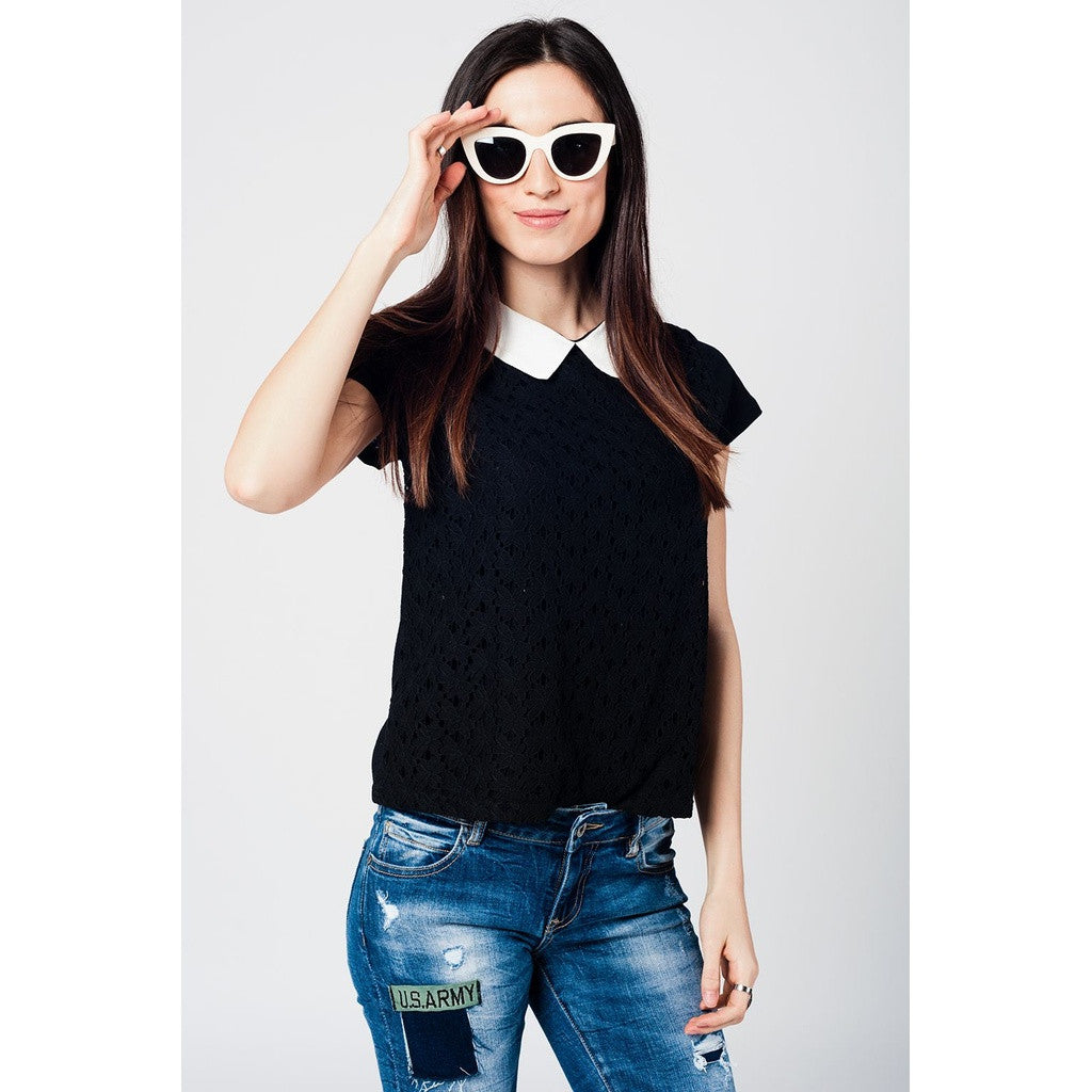 Knit black top with floral brocade in the front and neck contrast