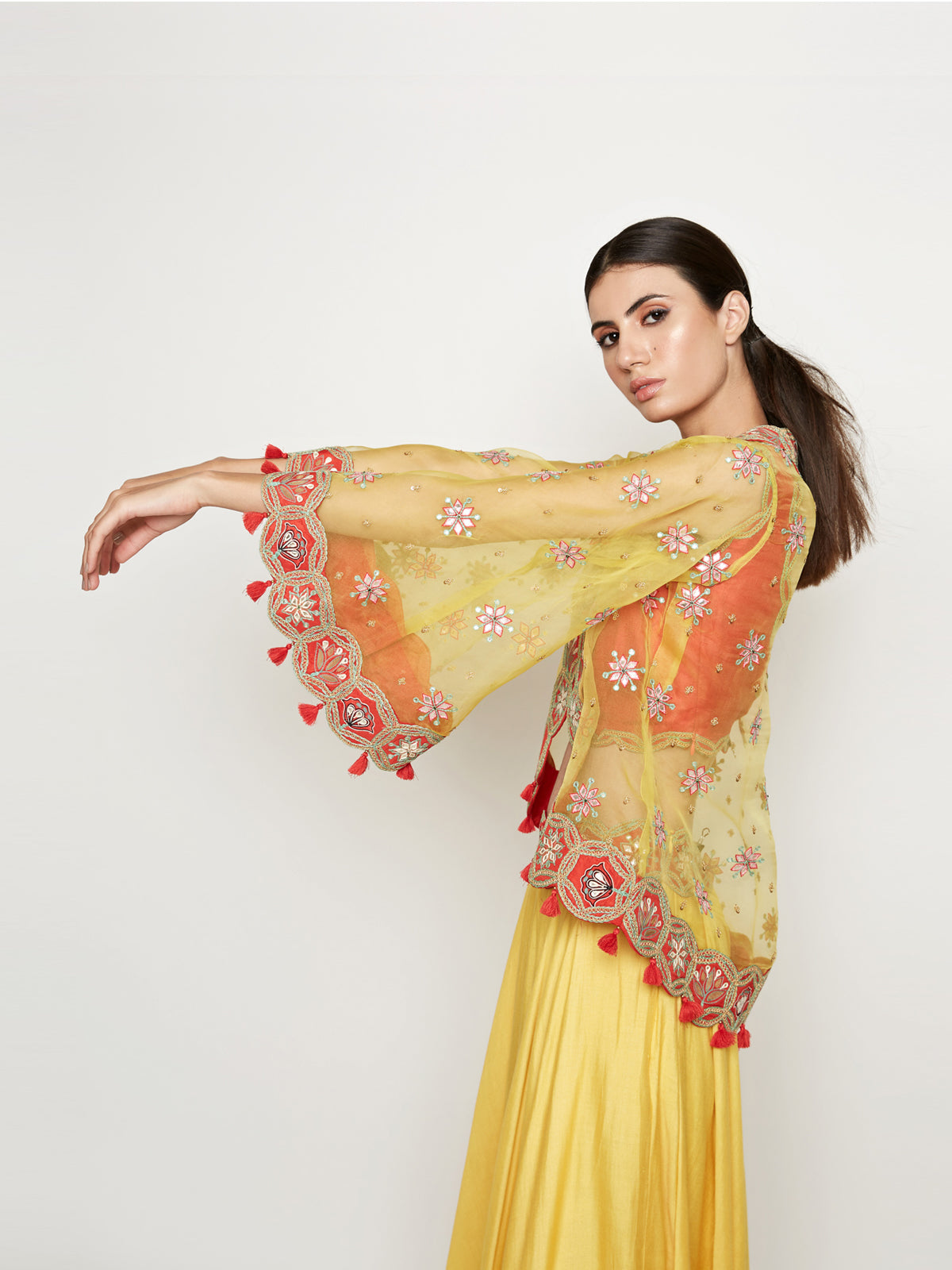 YELLOW LEHENGA WITH TOP AND EMBROIDERED CAPE