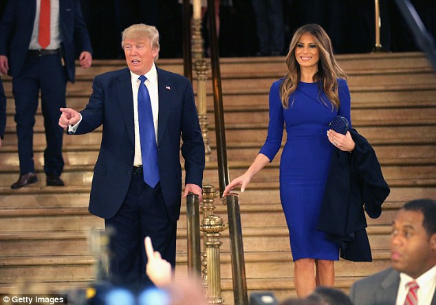 Melania  elegance in an electric blue gown with her hair flowing