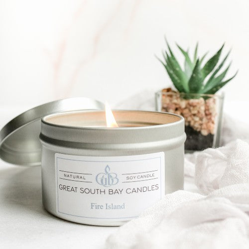 scented soy candles in travel tin containers