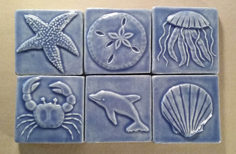 sea life handmade tiles in blue glaze, three inch size