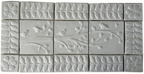 "handmade tile set, ""birds on a branch with 3"" border"" in white glaze"