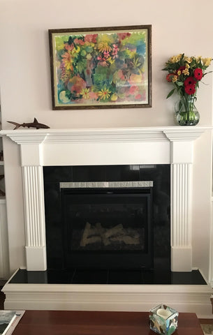 black and white hearth featuring handmade tiles and white wood work