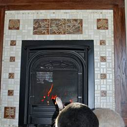 handmade tile hearth with bunnies in foreground