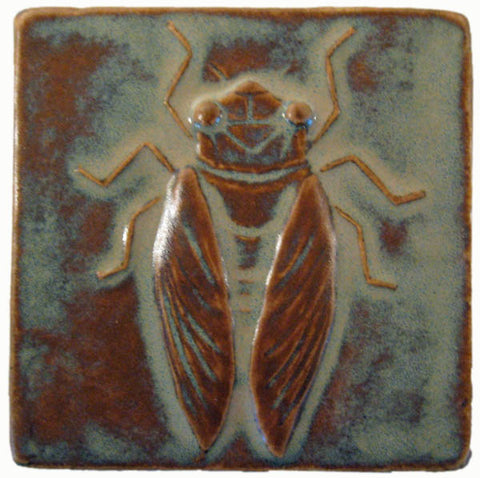 handmade tile with a cicada design in a four inch size