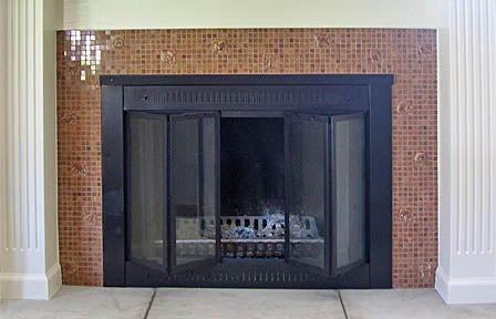 Fireplace surround with hand-made ceramic tiles 1