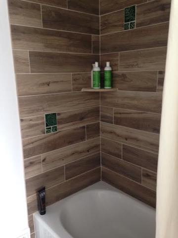 handmade tile shower with wood grain look tiles