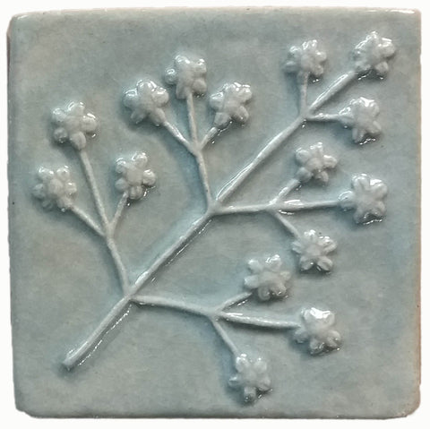 delicate floret four inch by four inch handmade tile in celadon glaze
