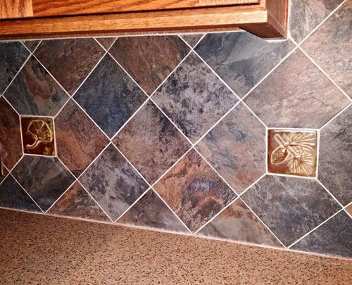handmade tiles mixed with slate tiles in a kitchen backsplash