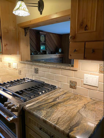 handmade maple leaf tiles installed in a kitchen