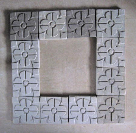 some unglazed unfired bisqued ceramic arts and crafts tiles