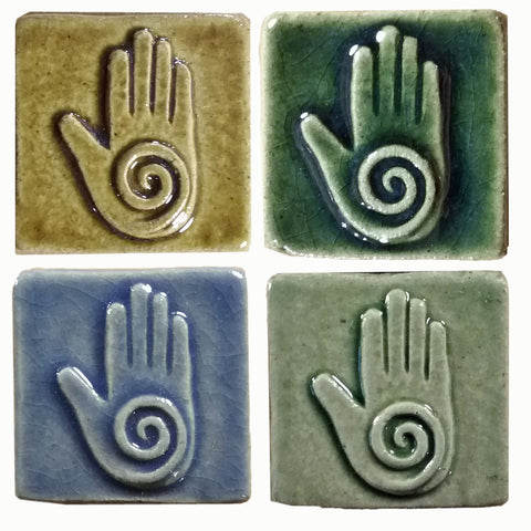 healing hand handmade tiles in four different glazes, two inch by two inch size
