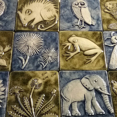 four inch size handmade tiles featuring plants and animals, blue and green glazes