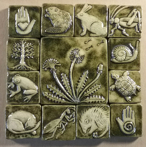 dandelion handmade tile with a two inch border, copper green glaze