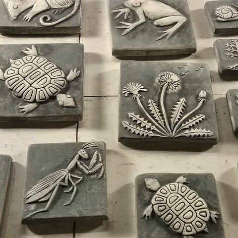 handmade tiles in the process of being glazed