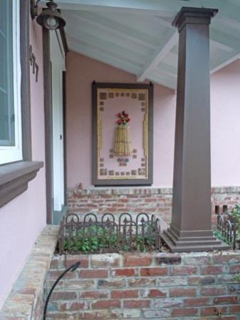arts and crafts home with handmde art tile entryway